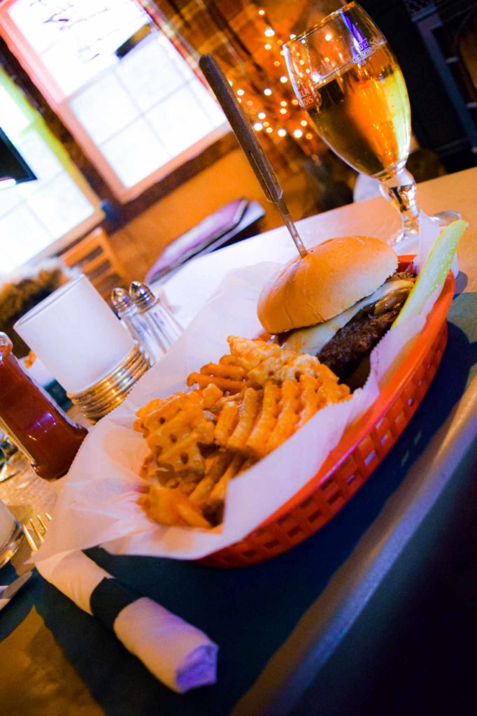 Enjoy a signature PLI burger at The Inn.